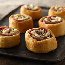 Mediterranean Crescent Pinwheels    My husband LOVES these.  You can make them with any type of sliced meat (ham, turkey, roast beef).