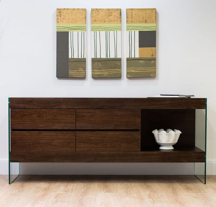 The rich, dark colour of the wood juxtaposed with clear thin table legs make the Aria Glass and Espresso Dark Wood Sideboard look super modern.