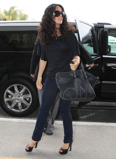 Airport Dressing 101: Take a Nod From These Celebs: Olivia Munn showed that the classic combo of a t-shirt and jeans can still be ultrastylish.   : Salma Hayek went for all-black everything in her draped top, which she styled with sleek jeans, a pair of peep-toe pumps, and the ultimate carry-on: a Bottega Veneta bag.