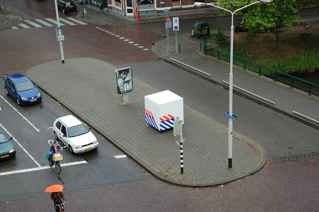 Sil Krol - White Cube with Blue and Orange Stripes, Illegal intervention, wood, steel, police striping, Breda, 2010.  #art #intervention #illegal #contemporary #public #space #police #striping