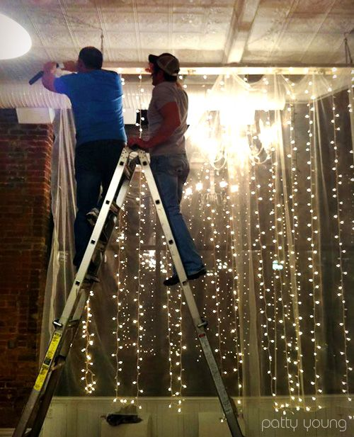 hang a vertical string of lights from a rod and add the sheer to soften it - Christmas Light Store