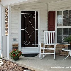 aluminum screen door on front porch with rocking chairs