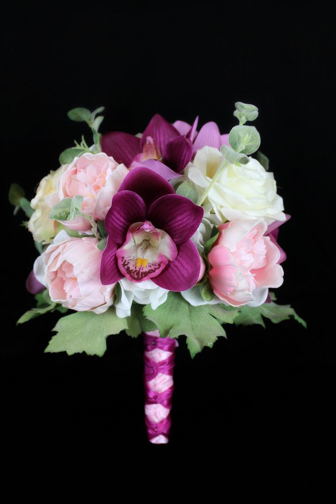 A peony orchid and rose dream brides bouquet bride
