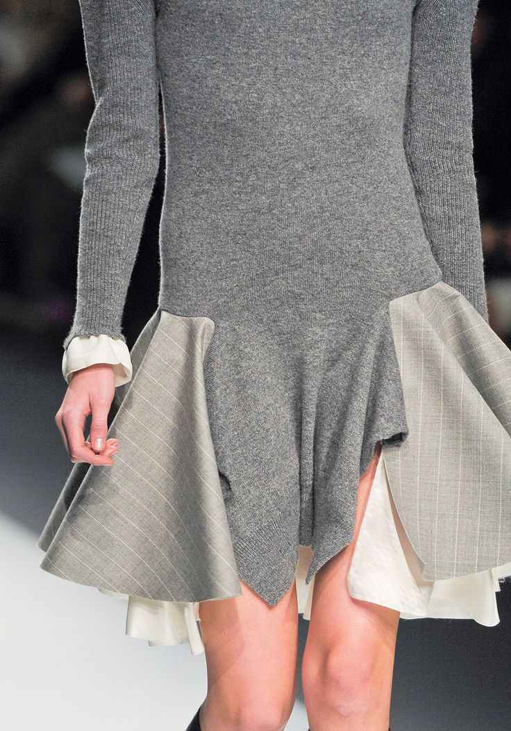 """extraordinary Japanese designer Chitose Abe, Sacai (Fall 2012), genius at fusing knits with woven fabrics ...""""little sweaters & cardigans with minimal, ruffly edges in viscose & lingerie lace...gradually, the sweaters would be paired up with men's shirts, & eventually those pieces became dresses...there's always a lot going on in a look—the front in a different fabric than the back, skirts part-pleated, part lace—but every item could be pulled on ... as easily as a sweater...' > from Vogue"""
