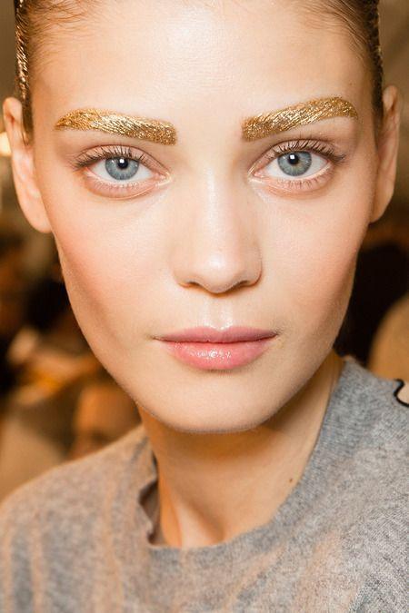 Golden eyebrows. Statement makeup look. Stage make up