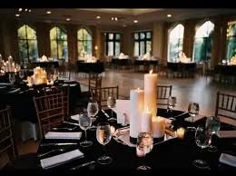 Love the black tablecloths & candle clusters - no floral needed (could do red petals too)