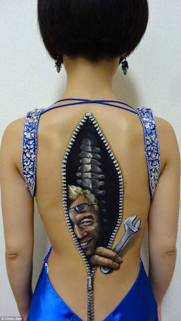 Japanese artist makes models burst at the seams with creepy zips, buttons, power plugs and laces painted on their skin