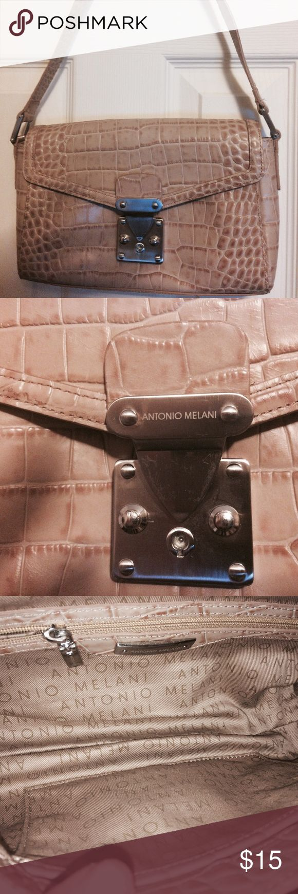 Pocketbook Very nice pocketbook in like new condition. Never used. ANTONIO MELANI Bags