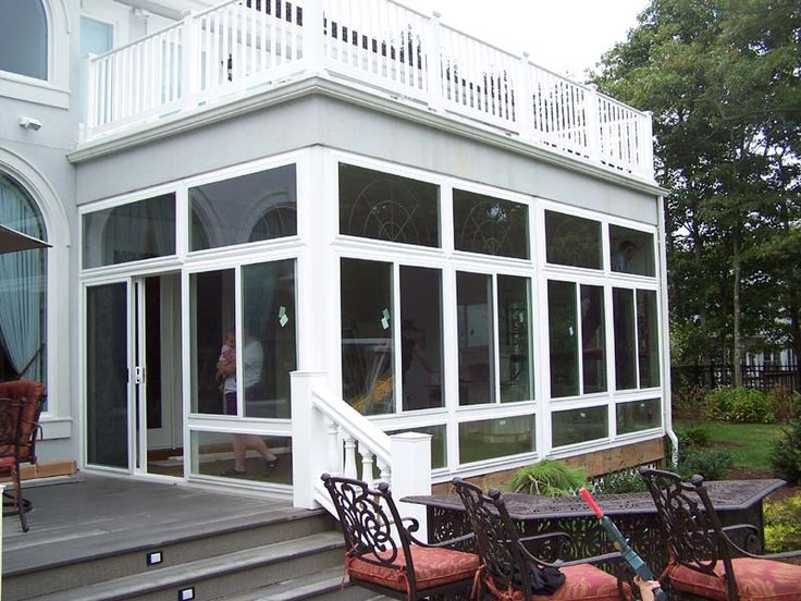 Enclosed porches sunrooms vinyl patio enclosures for Sunroom and patio designs