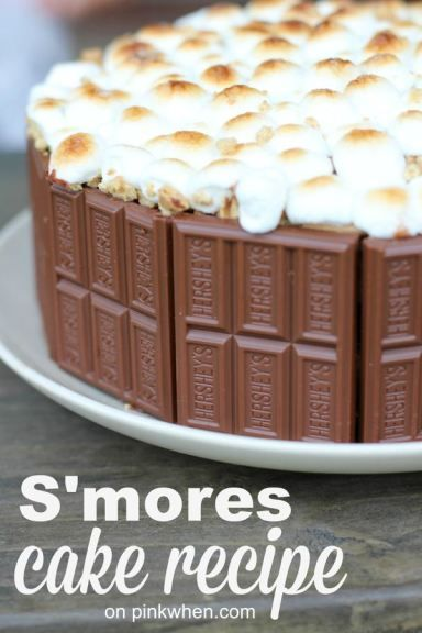 This delicious S'mores layered cake uses Hershey's Chocolate frosting, Hershey bars, crumbled graham crackers, and with a toasted marshmallow topping! Perfect dessert S'mores cake recipe you HAVE to save and try!