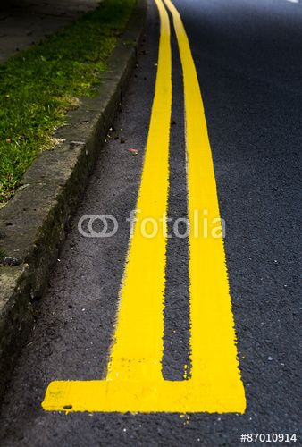 start of double yellow lines curving round bend