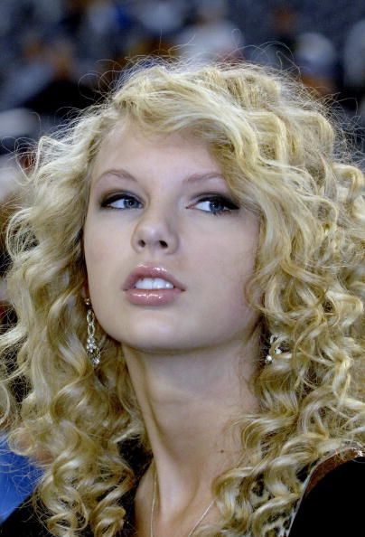 Taylor Swift sings the National Anthem as the Detroit Lions host the Miami Dolphins in a Thanksgiving Day game Nov 23 2006 in Detroit