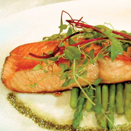 """Salmon: Great for heart health, but here's an added twist: New studies are suggesting that monounsaturated fats and omega-3 fats might help lessen abdominal fat. It's too soon to understand the link, but """"this could be particularly good for women working to tone their core,"""" says Kleiner."""