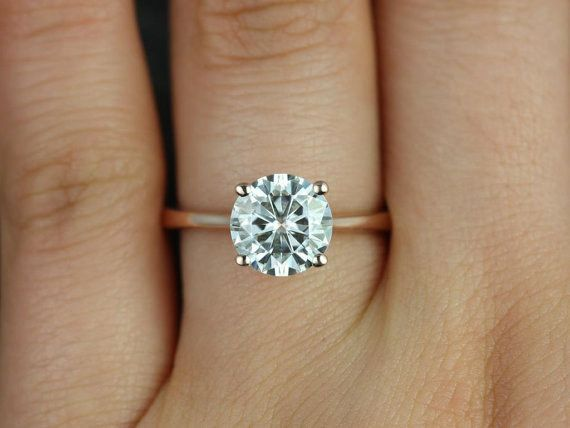This delicate rose gold moissanite engagement ring: | 32 Insanely Sparkly Engagement Rings That Don't Use A Single Diamond