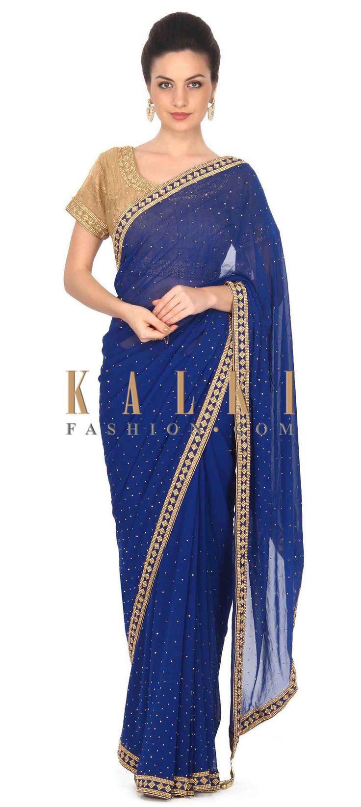Buy this Royal blue saree adorn in kundan embellished border only on Kalki