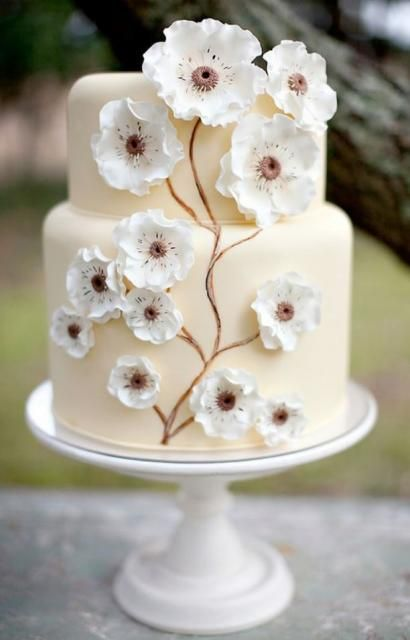 Two tier petite ivory wedding cake with white floral decor.JPG