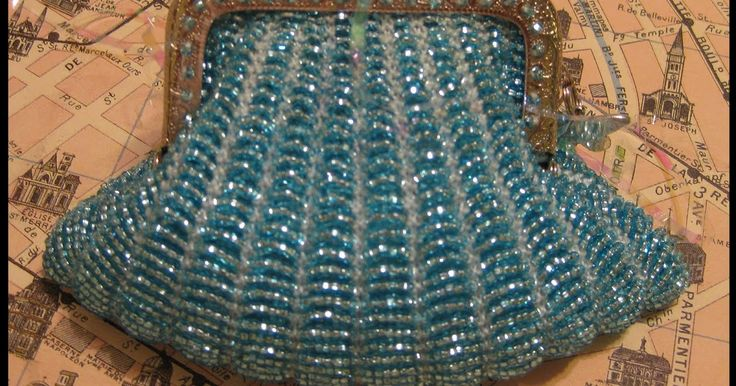 And yet, another bead-knitted change purse - this time in aqua with a silver-tone frame and butterfly charm. Speaking of beads... Look wha...
