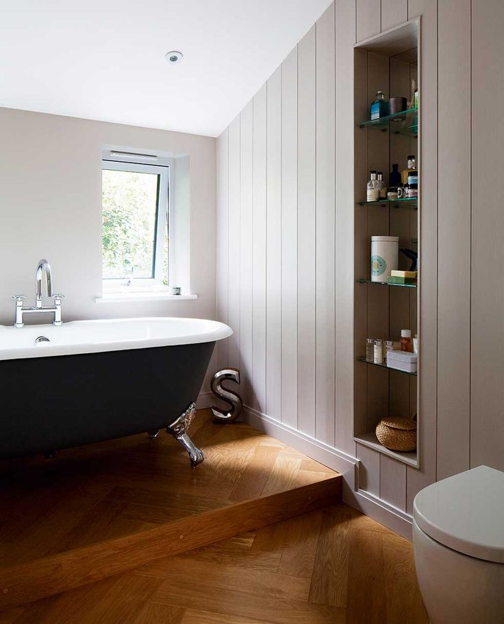 The bathroom has a raised platform for the freestanding ...