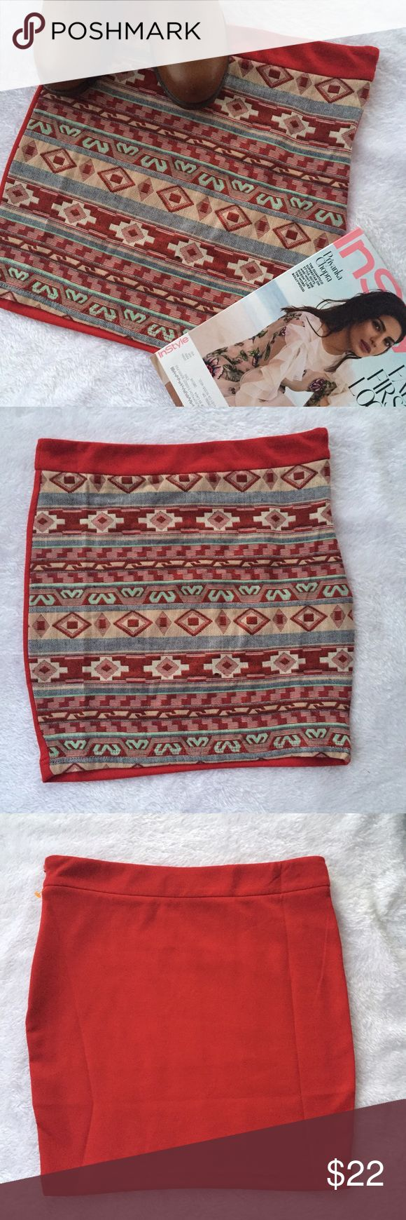 """Aztec print skirt in red Very pretty in person . Beautiful Aztec print with plain red back with side zipper . Waist measures 30"""" length 16"""". Material is 76% polyester 20% rayon 4% spandex . Boutique Skirts Mini"""