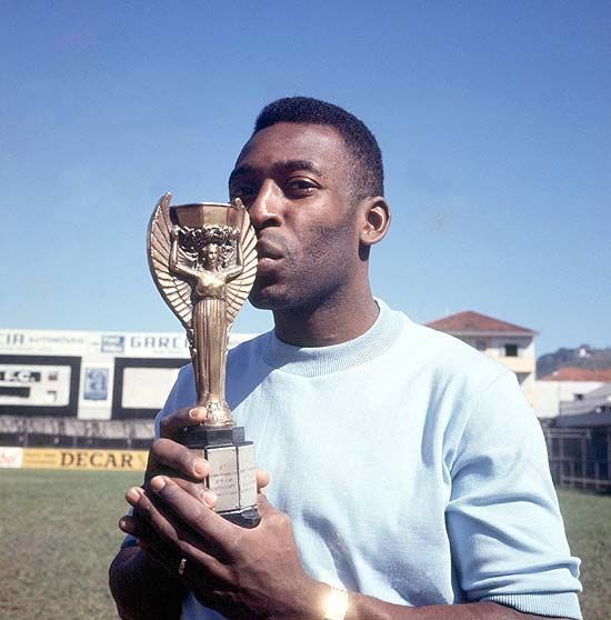 Pelé kisses the Jules Rimet trophy. He played in all of the Brazil football teams which won the FIFA World Cup in 1958, 1962 and 1970.