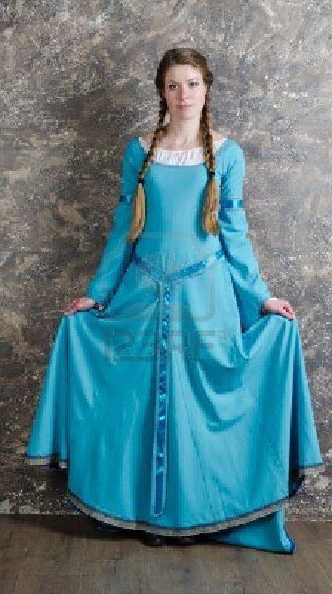 pretty young woman in historical medieval blue dress poses. Black Bedroom Furniture Sets. Home Design Ideas