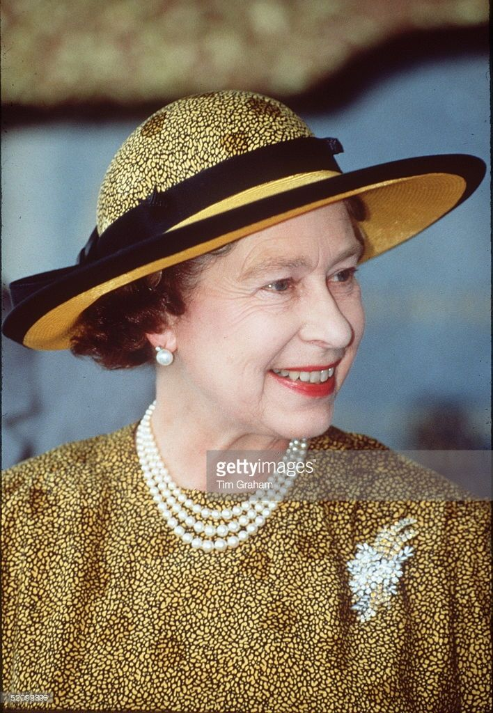 The Queen Smiling In Kuala Lumpur. She Is Wearing A Hat By Philip Somerville.
