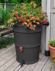 It's a rain barrel/flower pot!  Great idea