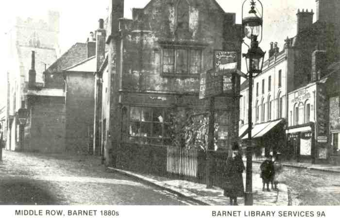 High Street Barnet. This is Middle Row before demolition - Barnet Church just visible behind