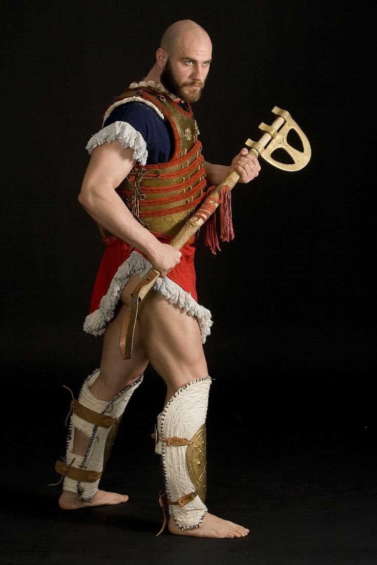 """Reconstruction of Mycenaean Warrior Armour of Late Bronze Age Era (1300-1200 BC)from a Middle Eastern Colony. The Armour is based onan interpretation of the """"Pylos tablets"""" and the newly discovered """"Thebes Arsenal"""". The """"Epsilon Blade"""" Axe is based on exhibits  from the National Archaeological Museum . This type of axe was  used in the eastern Mediteranean from the 2nd millenium BC and could cause serious damage to the enemy ."""