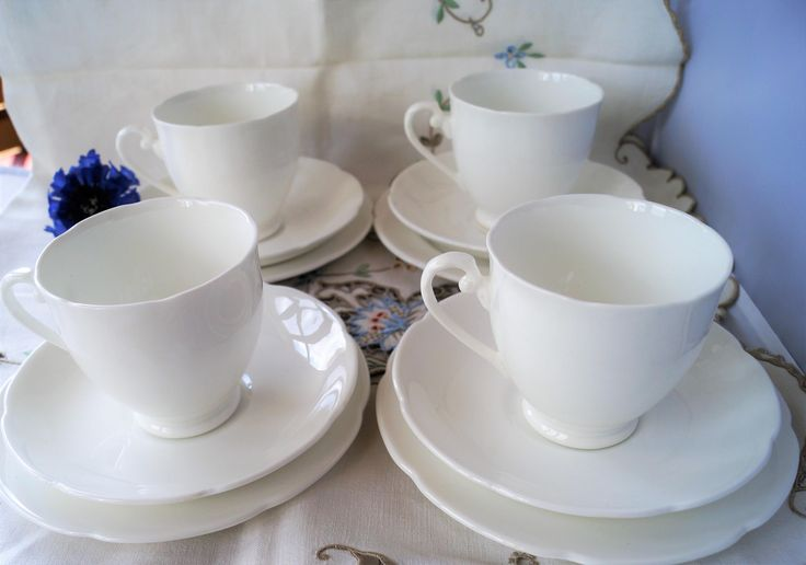 A vintage 12 piece tea set of pure white dainty porcelain. The classic style works well with both vintage and contemporary tea ware. by Alexsprettyvintage on Etsy