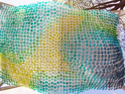 Quirky parking canopy made from 1,500 recycled plastic bottles