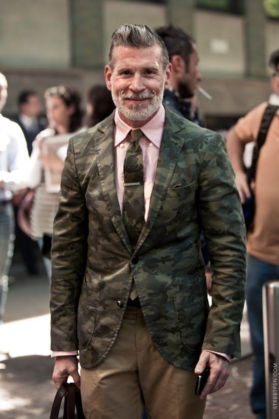 Something as simple as teaming an olive green camo sportcoat with khaki casual pants can potentially set you apart from the crowd.   Shop this look on Lookastic: https://lookastic.com/men/looks/olive-blazer-pink-dress-shirt-khaki-chinos/19741   — Pink Dress Shirt  — Olive Camouflage Tie  — Olive Camouflage Blazer  — Khaki Chinos