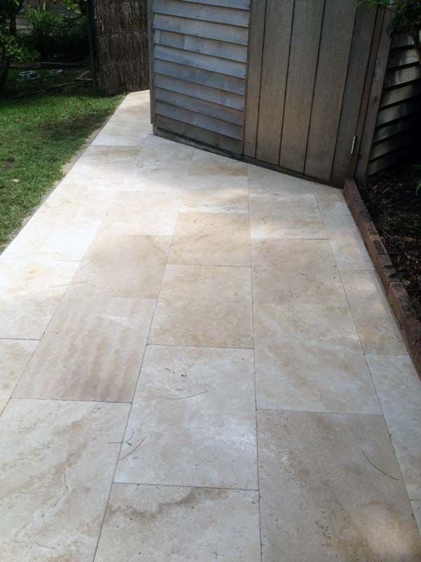 Beautiful pathway in Killara. Travertine supplied by Gaia Stone, job performed by Grand Paving.
