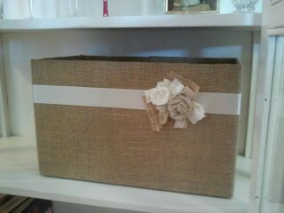 Burlap covered bin made from a cardboard box.