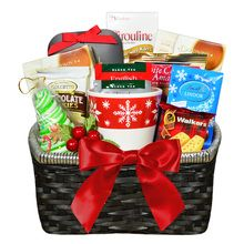 Perfect way to send holiday wishes to the tea lover! Attractive gift basket filled with a variety of holiday delights.