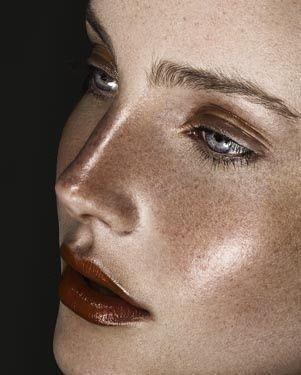 Glowing skin/metalic sheen dull lips and brushed up brows