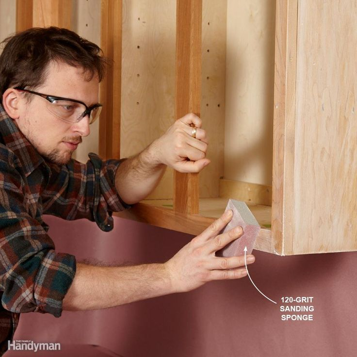 Don't Go Overboard on Sanding - You should sand cabinets before painting them to give the new paint a good surface to grip. But you don't need to sand to bare wood. If your cabinets have a factory finish, sand lightly with 120-grit sandpaper or a sanding sponge. If the surface is rough from a previous paint job or poor varnishing job, start with coarser 100-grit paper to remove bumps. Then sand again with 120-grit to get rid of any sanding marks.