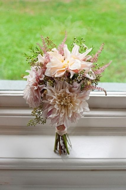 The bridesmaids will have loose clutch bouquets of blush pink dahlias, burgundy scabiosa, white wax flowers, blush pink spray roses, pale pink astilbe, and green seeded eucalyptus wrapped in natural burlpap.
