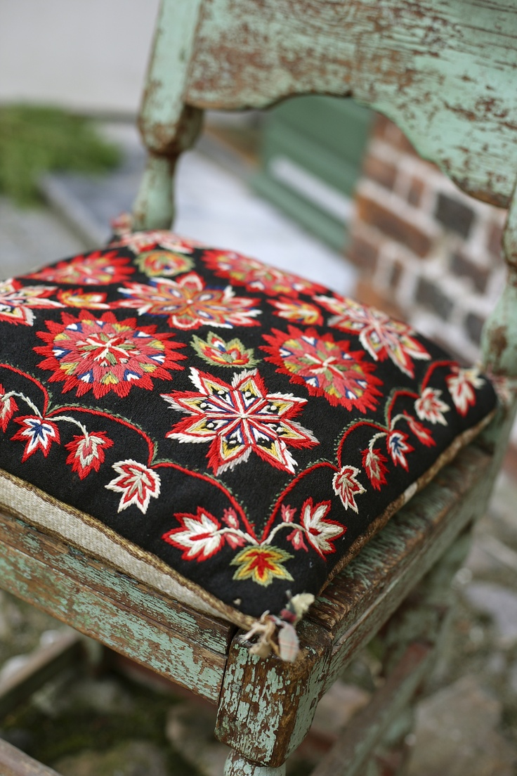 Gorgeous woolen embroidered cushion.