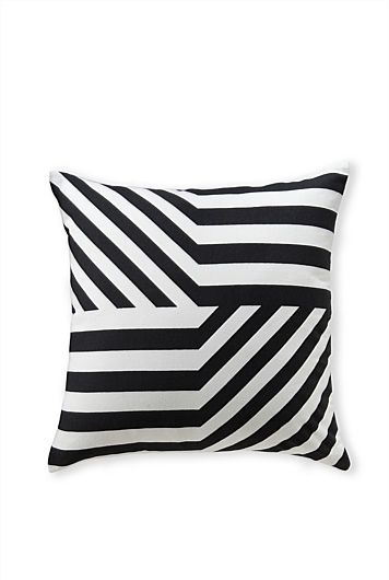 The sevri cotton cushion from country road is designed with an asymmetrical twist that brings graphic focus to sofas and bedding