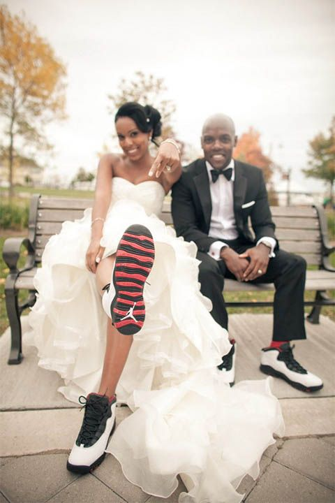 Oakville Conference Centre Wedding | Cara and Leon | Instead of the usual heels and dress shoes, this couple opted for Air Jordans for their footwear! Photography session in Bronte Outer Harbour Marina :) #torontoweddingphotographer #weddingphotography #weddingshoes ~ http://www.focusproduction.ca/oakville-wedding-at-bronte-outer-harbour-marina-cara-and-leon/