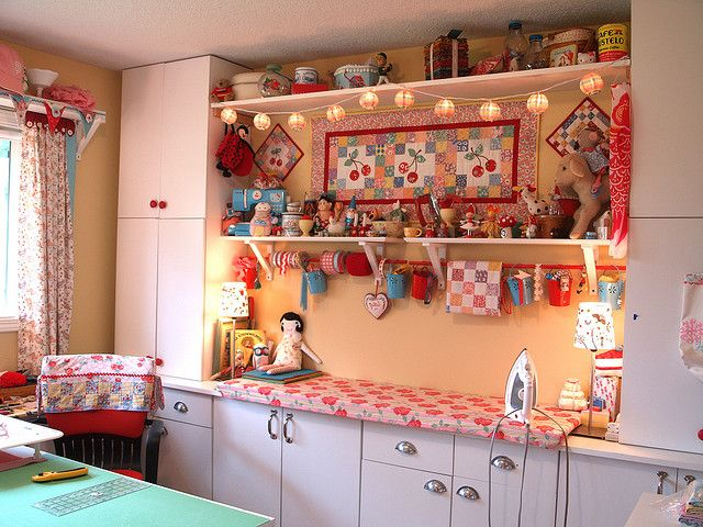 pretty darn cute sewing studio. Like the ironing surface on the opening shelving
