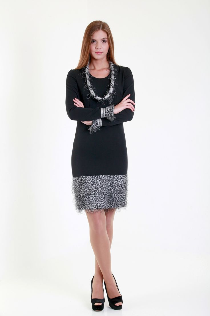 Simple cut black dress with the unexpected twist of grey fur necklaces - style for the daring ladies.