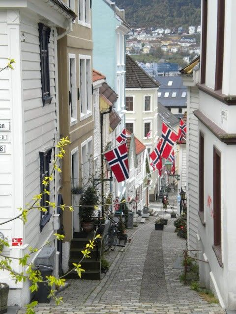 Norwegian flags attached to the buildings in the Norwegian streets. //Norway…