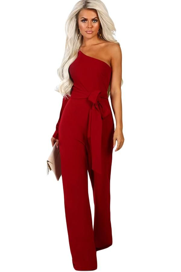 8d30df9dafb ... •The jumpsuit is solid and asymmetric •One shoulder style with a cuffed  split sleeve •Fitted bodice and wide leg pants with tie waist belt •Made of  soft ...