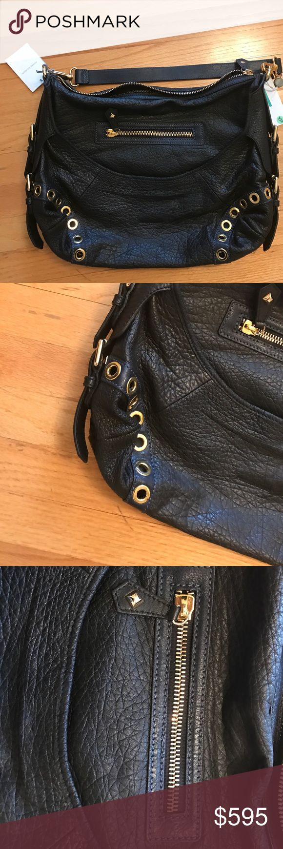 New Pierre Balmain handbag Pierre Balmain large handbag from 2014 collection. Soft textured leather, logo embossed on front but very subtle as you can see in pic. Zip closure. Removeable handle. Measurements approximate. Beautiful bag. The first two pics are of bag which is currently on sale for $1400 so the retail was prob 2800. The rest of the pics are actual bag. Authentic.  I bought this bag as a special treat for myself, but its too  big for my petite frame.  Please feel free to message…