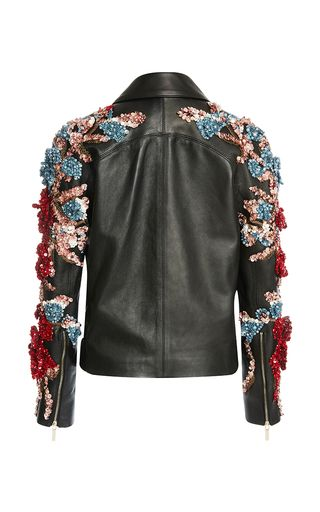 This **Elie Saab** perfecto jacket, rendered in leather, features gold hardware and raised crystal embroidery through the sleeve.