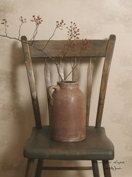 Old brown crock jug with berries on antique wood chair - Luv it!