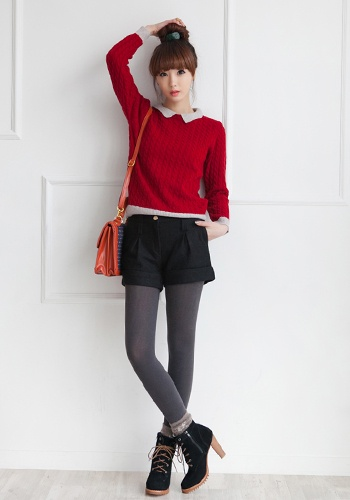 Red sweater over button up with black tights