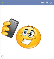 If you like taking selfies, this smiley might be perfect for you to share in your next status update.